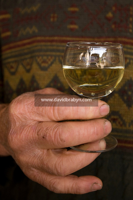 Winemaker Daniel Jarry holds a glass of his own production in Vouvray, France, 26 June 2008.