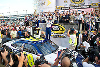 HOMESTEAD, FL - NOVEMBER 21, 2010: Jimmy Johnson, driver of the #48 Lowes Chevrolet celebrates his fifth consecutive Sprint Cup Championship following the NASCAR Sprint Cup Series Ford 400 at the Homestead-Miami Speedway..(Photo by Phil Ellsworth / ESPN)..- RAW FILE AVAILABLE -