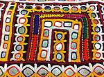 VINTAGE BAANTH WITH SUPERIORI KUTCH EMBROIDERY. THE ORANGE TRIMS HAVE BEEN ADDED RECENTLY. SIZE ABOUT 2 METRES. MAY BE WORN AS A STOLE, WRAP OR ODHNI