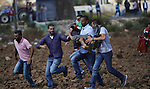 Palestinian protesters throw stones during clashes following a demonstration against the Israeli police raid on Jerusalem's al-Aqsa mosque, in the West Bank, Jewish settlement of Beit El, north of Ramallah September 29, 2015. New clashes broke out between Palestinians and Israeli police who stormed Jerusalem's flashpoint Al-Aqsa mosque compound, as an expected increase in Jewish visitors to the site over the Sukkot holiday boosted tensions. Jews are allowed to visit the site, but cannot pray to avoid provoking tensions. Muslims fear Israel will seek to change rules governing the compound, which is located in Israeli-annexed east Jerusalem. Photo by Shadi Hatem
