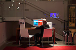 October 16, 2012. Raleigh, North Carolina.. A computer was available for attendees to chat and comment on the debate with others attending the exhibitions.. Locals gathered at the Contemporary Art Museum to see artist Jonathan Horowitz's simultaneous exhibitions about the presidential election titled ?Your Land/My Land?..  A room is divided in two, with blue carpet, democrats on one side, and red carpet, republicans, on the other. TV's on both sides are supposed to play either FOX news, red, or CNN, blue. Because of the audio delay between the 2 channels, both sides played CNN during the 2nd presidential debate..