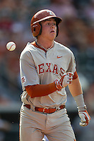 Texas Longhorns first baseman Kacy Clemens (42) hustles down the first base line as the ball is thrown past him during the NCAA baseball game against the Houston Cougars on June 6, 2014 at UFCU Disch–Falk Field in Austin, Texas. The Longhorns defeated the Cougars 4-2 in Game 1 of the NCAA Super Regional. (Andrew Woolley/Four Seam Images)