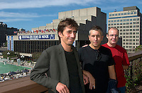 Spanish director  Juanjo GimÈnez Pena (R),<br />  Actor Pepe Pereza (M)<br />  and Co-scriptwriter Miguel Ange lBaixauli (L)<br />  pose for an exclusive photo in front of the Maisonneuve Theater after the press conference for his first movie `TILT (Nos Hacemos Falta) presented in the official  competition at the 25thWorld Film Festival in Montreal , Canada, September 2nd 2001.<br /> <br /> <br /> Photo by Pierre Roussel / Getty Images News Service (ON SPEC)<br /> <br /> <br /> <br /> NOTE : Nikon D-1 JPEG opened with QUIMAGE ICC profile , saved as Adobe RG 1998 color space.