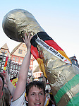 30 June 2006: A fan carries a giant Jules Rimet Trophy into the crowd as Germany fans celebrate in the town square in Frankfurt, site of several games during the FIFA 2006 World Cup. Germany had just defeated Argentina in a Quarterfinal game played in Berlin.