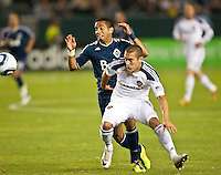 CARSON, CA - September 17, 2011: Vancouver Whitecaps midfielder Camilo (37) and LA Galaxy defender Bryan Jordan (27) during the match between LA Galaxy and Vancouver Whitecaps at the Home Depot Center in Carson, California. Final score LA Galaxy 3, Vancouver Whitecaps 0.