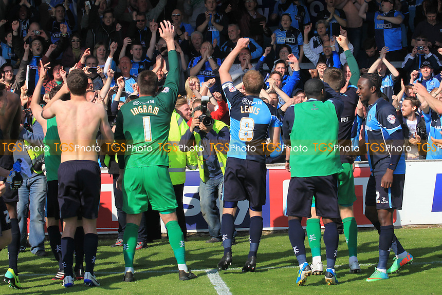 Wycombe players celebrate in front of their fans as they retain their Football League status - Torquay United vs Wycombe Wanderers - Sky Bet League Two Football at Plainmoor, Torquay, Devon - 03/05/14 - MANDATORY CREDIT: Paul Dennis/TGSPHOTO - Self billing applies where appropriate - 0845 094 6026 - contact@tgsphoto.co.uk - NO UNPAID USE