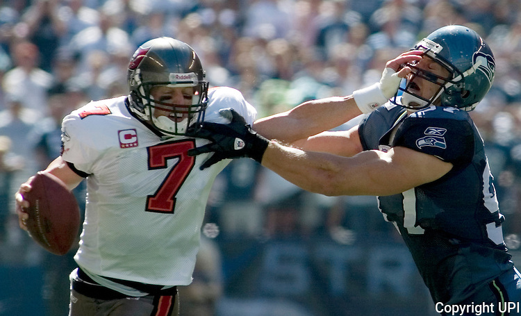 Tampa Bay Buccaneers quarterback Jeff Garcia (L)  tries to get away from  Seattle Seahawks Patrick Kerney in the second quarter of their season opener at Qwest Field in Seattle on September 9, 2007. (UPI Photo/Jim Bryant).