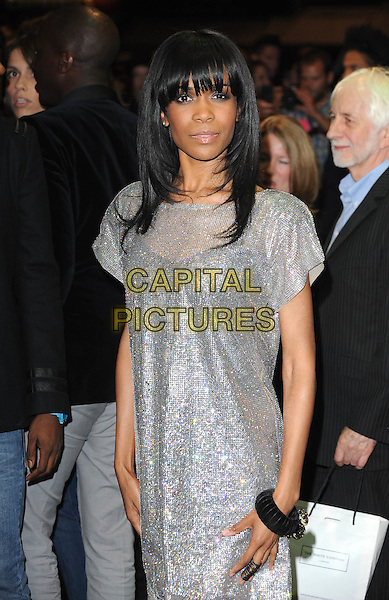MICHELLE  WILLIAMS of Destiny's Child .Attending attending the preview of Ozwald Boateng's first feature length film, 'A Man's Story' and Fashion Show during the final day of London Fashion Week, Odeon cinema Leicester Square London, England, UK, .September 22nd 2010. .half length silver sparkly dress bangle bracelet chainmail chain mail  glittery.CAP/BEL.©Tom Belcher/Capital Pictures.