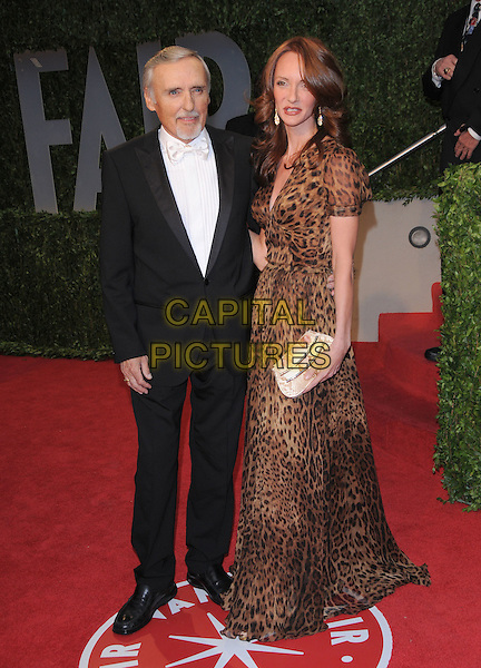 DENNIS HOPPER & VICTORIA DUFFY .at The 2009 Vanity Fair Oscar Party held at The Sunset Tower Hotel in West Hollywood, California, USA, .February 22nd 2009                                                                                      .oscars after full length black suit leopard print animal dress long maxi .CAP/DVS.©Debbie VanStory/Capital Pictures