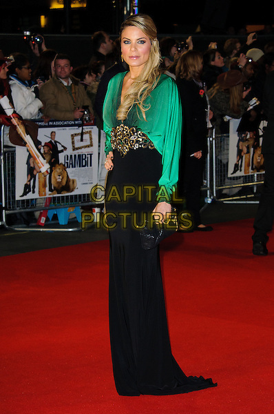 Charlotte Jackson.'Gambit' world film premiere, Empire cinema, Leicester Square, London, England..7th November 2012.full length black top skirt belt embellished green blouse low cut neckline clutch bag.CAP/CJ.©Chris Joseph/Capital Pictures.