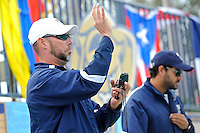 14 January 2012:  FIU Swimming Head Coach Randy Horner signals to one of his swimmers during pre-meet warm-ups.  The FIU Golden Panthers won the meet with the Central Connecticut State University Blue Devils at the Biscayne Bay Campus Aquatics Center in Miami, Florida.