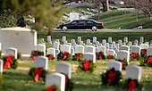 The motorcade carrying United States President Barack Obama and Prime Minister Nouri  al-Maliki of Iraq makes his way past the graves of soldiers adorned with holiday wreaths as they make their way to a ceremony at Arlington National Cemetery for a wreath laying ceremony, Monday, December 12, 2011 in Arlington, Virginia..Credit: Olivier Douliery / Pool via CNP