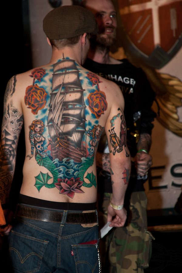 Copenhagen Inkfestival 2012. Old style sailboat tattoo on back with with mermaid and roses.