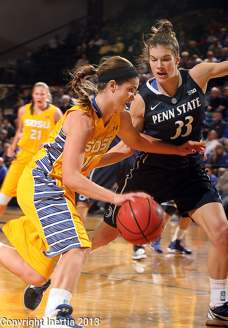 BROOKINGS, SD - DECEMBER 11:  Steph Paluch #15 from South Dakota State University drives against Maggie Lucas #33 from Penn State in the first half of their game Wednesday night at Frost Arena in Brookings. (Photo by Dave Eggen/Inertia)