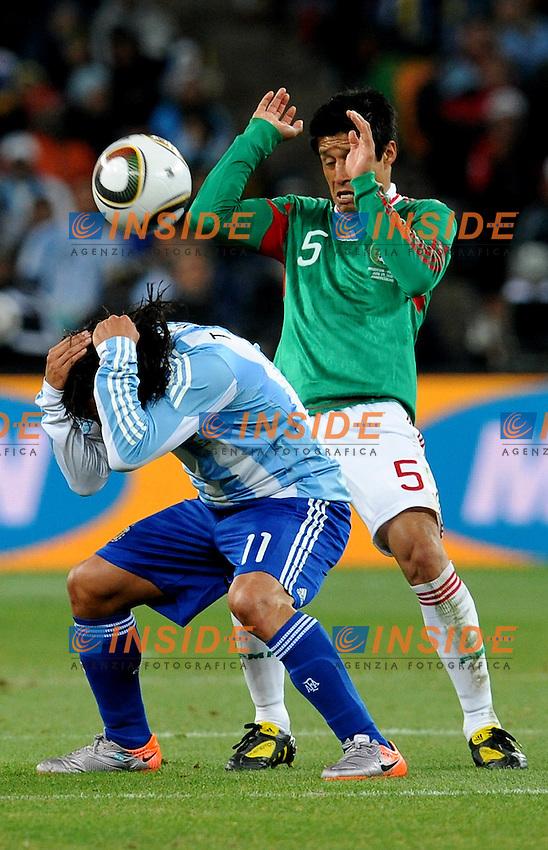 Carlos Tevez (Argentina) e Ricardo Osorio (Messico)<br /> Argentina Messico - Argentina vs Mexico<br /> Campionati del Mondo di Calcio Sudafrica 2010 - World Cup South Africa 2010<br /> Soccer City Stadium, Johannesburg, 27 / 06 / 2010<br /> &copy; Giorgio Perottino / Insidefoto