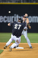 Josh Wilson (6) of the Toledo Mud Hens makes a throw to first base as Dan Black (27) of the Charlotte Knights slides into second base at BB&T BallPark on April 27, 2015 in Charlotte, North Carolina.  The Knights defeated the Mud Hens 7-6 in 10 innings.   (Brian Westerholt/Four Seam Images)