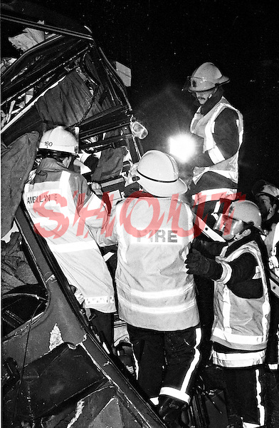 Firefighters and Paramedic crews working together at a RTC involving a coach that has left the motorway and hit a concrete bridge support Oxfordshire UK. This image may only be used to portray the subject in a positive manner..©shoutpictures.com..john@shoutpictures.com