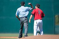 Umpire Emil Jimenez ejects Kannapolis Intimidators manager Justin Jirschele (9) for arguing a call during the game against the Asheville Tourists at Kannapolis Intimidators Stadium on May 7, 2017 in Kannapolis, North Carolina.  The Tourists defeated the Intimidators 4-1.  (Brian Westerholt/Four Seam Images)
