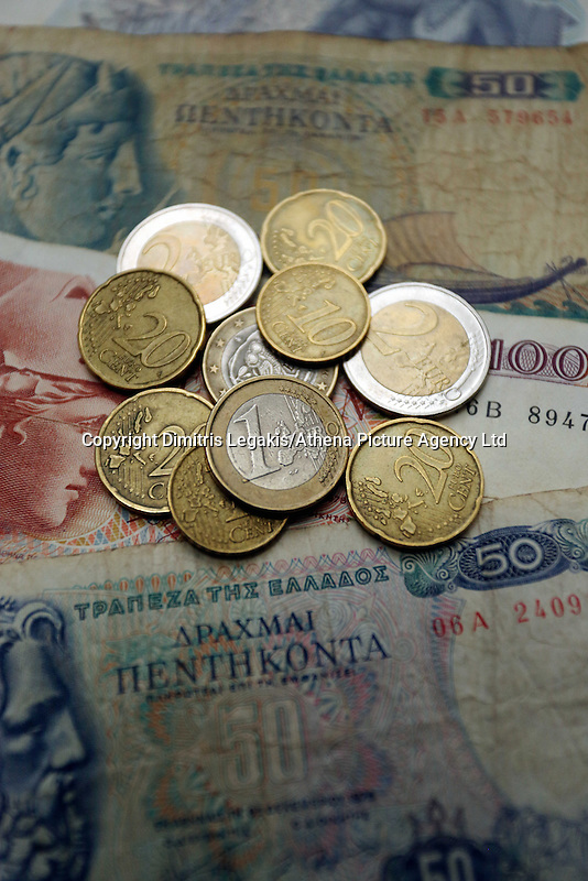 A mixture of old drachma paper notes along with euro coins<br /> Re: The forthcoming elections in Greece has severely de-stabilised the currency and stock markets in Europe and the rest of the world.
