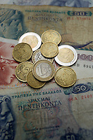 A mixture of old drachma paper notes along with euro coins<br />