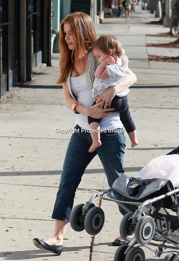 """.9-27-08  Exclusive .Isla Fisher ate lunch with her baby and some friends at a store called """"American Rag"""" in Los Angeles ca...AbilityFilms@yahoo.com.805-427-3519.www.AbilityFilms.com."""