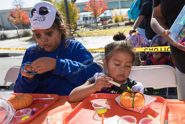 Destiny and 3-year-old Ayanna decorate pumpkins during Pumpkin Palooza in Sparks, Nevada on Sunday, Oct. 22, 2017.