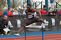Lewis University freshman Mervyn John (Jefferson City High School) clears a hurdle on his way to winning his section and taking 14th overall in the men's 400-meter hurdles in 55.71 at the 2015 Kansas Relays.