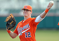 First baseman Jon McGibbon (12) of the Clemson Tigers in a game against the Eastern Michigan Eagles on Friday, Feb. 18, 2011, at Doug Kingsmore Stadium in Clemson, S.C. Photo by Tom Priddy / Four Seam Images