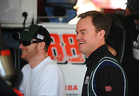 Nov. 13, 2009; Avondale, AZ, USA; NASCAR Sprint Cup Series driver Dale Earnhardt Jr with crew chief Lance McGrew (right) during practice for the Checker O'Reilly Auto Parts 500 at Phoenix International Raceway. Mandatory Credit: Mark J. Rebilas-