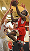 Troy Goode #4 of Center Moriches, right, drives to the net for two points during a Suffolk County League VII varsity boys basketball game against host Babylon High School on Friday, Jan. 26, 2018. Center Moriches won by a score of 84-80.