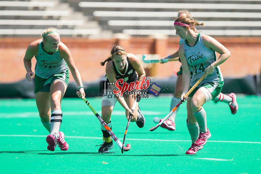 Christine Conroe (4) of the Wake Forest Demon Deacons is double teamed by Jesse Ebner (10) and Esty Byrd (14) of the William & Mary Tribe during second half action at Kentner Stadium on September 15, 2013 in Winston-Salem, North Carolina.  The Demon Deacons defeated the Tribe 4-0.  (Brian Westerholt/Sports On Film)