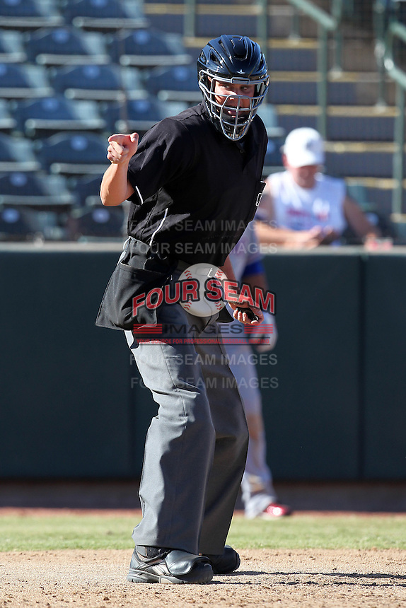 Home plate umpire Jordan Baker during an Arizona Fall League game between the Phoenix Desert Dogs and Surprise Saguaros at Phoenix Municipal Stadium on October 29, 2011 in Phoenix, Arizona.  Surprise defeated Surprise 11-0.  (Mike Janes/Four Seam Images)