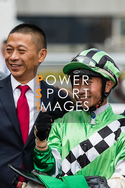 Jockey Dylan Mo Hin-tung, who rode #6 Green Energy, (C) and trainer Danny Shum Chap-shing (L2) pose for photo after winning the race 5 during Hong Kong Racing at Sha Tin Racecourse on October 01, 2018 in Hong Kong, Hong Kong. Photo by Yu Chun Christopher Wong / Power Sport Images