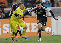 WASHINGTON, DC - OCTOBER 20, 2012:  Chris Pontius (13) of D.C United breaks away from Chris Birchall (8) of the Columbus Crew during an MLS match at RFK Stadium in Washington D.C. on October 20. D.C United won 3-2.