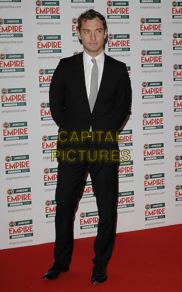 JUDE LAW .At the Jameson Empire Film Awards, Grosvenor House Hotel, Park Lane, London, England, UK, March 28th 2010..Arrivals full length black suit grey gray tie white shirt .CAP/CAN.©Can Nguyen/Capital Pictures
