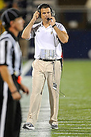 1 September 2011:  FIU Head Football Coach Mario Cristobal checks the scoreboard in the first half as the FIU Golden Panthers defeated the University of North Texas, 41-16, at University Park Stadium in Miami, Florida.