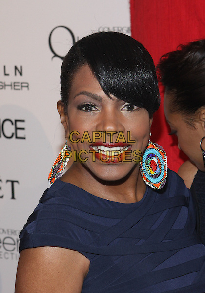 SHERYL LEE RALPH.The Third Annual ESSENCE Black Women In Hollywood Luncheon held at The Beverly Hills Hotel in Beverly Hills, California, USA. .March 4th, 2010 .headshot portrait blue purple circle disc earrings white blue red lipstick .CAP/ADM/TC.©T. Conrad/AdMedia/Capital Pictures.