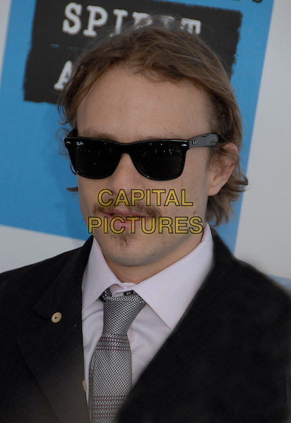 HEATH LEDGER.The 2007 Independent Spirit Awards held at the Santa Monica Pier, Santa Monica, California, USA..February 24th, 2007.headshot portrait mustache facial hair sunglasses shades .CAP/ADM/GB.©Gary Boas/AdMedia/Capital Pictures