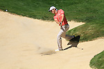 Padraig Harrington playing his second shot on the 5th from the bunker.during round three of the BMW PGA championship 2010 at Wentworth golf club, Surrey England..Picture Fran Caffrey/Newsfile.ie