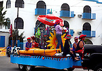 RED HAT SOCIETY FLOAT IN ANNUAL SAN FELIPE CARNIVAL PARADE