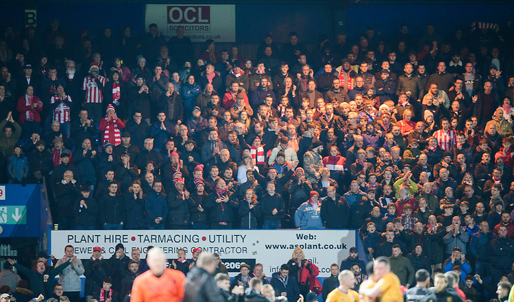 Lincoln City fans watch their team in action<br /> <br /> Photographer Chris Vaughan/CameraSport<br /> <br /> The EFL Sky Bet League Two - Mansfield Town v Lincoln City - Monday 18th March 2019 - Field Mill - Mansfield<br /> <br /> World Copyright © 2019 CameraSport. All rights reserved. 43 Linden Ave. Countesthorpe. Leicester. England. LE8 5PG - Tel: +44 (0) 116 277 4147 - admin@camerasport.com - www.camerasport.com