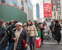 "Hordes of shoppers outside of Macy's Herald Square in New York on the day after Thanksgiving, Black Friday, November 28, 2014. Many retailers, including Macy's, opened their doors on Thanksgiving evening extending the shopping day and giving Thanksgiving the nickname ""Gray Thursday"". (© Richard B. Levine)"