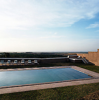 The outdoor swimming pool has spectacular views of the surrounding landscape