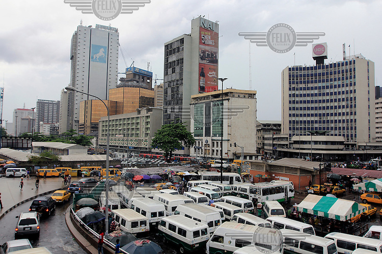 Parked mini vans and traffic heads slowly towards the highrises on Marina Street one of the city's commercial districts.