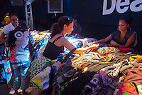 Shoppers browse heavily discounted merchandise at a Desigual pop-up store in the Dumbo neighborhood of Brooklyn in New York on Saturday, September 24, 2011. The Spanish retailer set up the pop-up shop as part of its sponsorship of the Dumbo Arts Festival taking place over the weekend. (© Richard B. Levine)