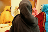 Acid victims are chatting in a bedroom at the Acid Survivors Foundation center in Islamabad, Pakistan-2009