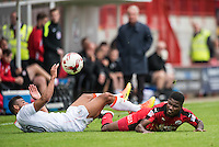 Isaac Vassell of Luton Town (20) and Andre Blackman of Crawley Town (14) challenge for the ball  during the Sky Bet League 2 match between Crawley Town and Luton Town at the Broadfield/Checkatrade.com Stadium, Crawley, England on 17 September 2016. Photo by Edward Thomas / PRiME Media Images.
