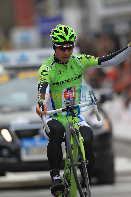 Peter Sagan (SVK) Cannondale Pro Cycling pops a celebratory wheelie as he crosses the finish line in Wevelgem alone to win at the end of the 75th edition of Gent-Wevelgem, Belgium, 24th  March 2013 (Photo by Eoin Clarke 2013)