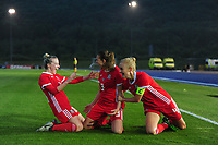 Kayleigh Green (centre) of Wales Women's' celebrates scoring the opening goal during the Women's International Friendly match between Wales and New Zealand at the Cardiff International Sports Stadium in Cardiff, Wales, UK. Tuesday 04 June, 2019