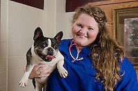 Class of 2015 student, Courtney Brown, poses with patient, Misty.